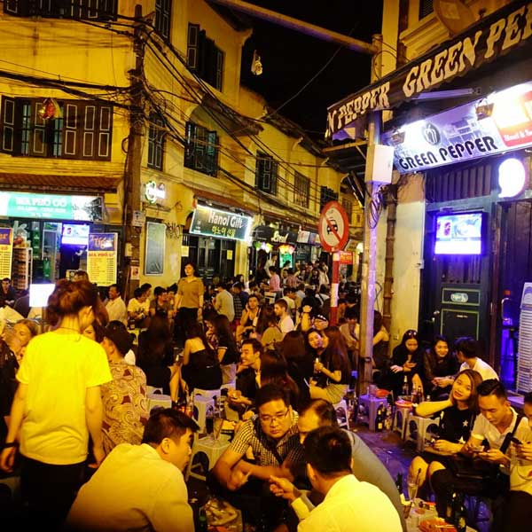 boozing-at-ta-hien-street-after-hanoi-night-market